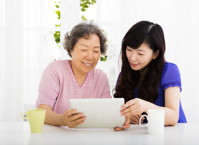 happy senior Mother and daughter learning  tablet pc